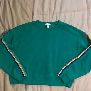 F21 Green sweatshirt with colorful striped sleeves